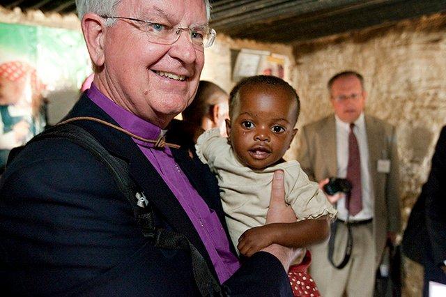 Dorf holding child