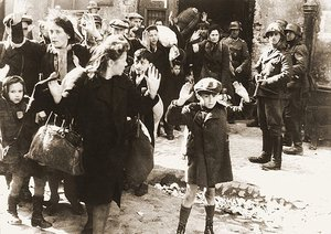 One of the most famous pictures of World War II shows Jewish women and children being arrested after the Warsaw Ghetto Uprising (Poland). The photo is from Jürgen Stroop Report to Heinrich Himmler from May 1943.