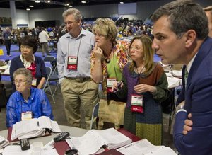 """Members of the Virginia delegation huddle to discuss possible next steps after the United Methodist Judicial Council ruled the proposed """"Plan UMC"""" for church restructuring to be unconstitutional during the 2012 United Methodist General Conference in Tampa, Fla."""
