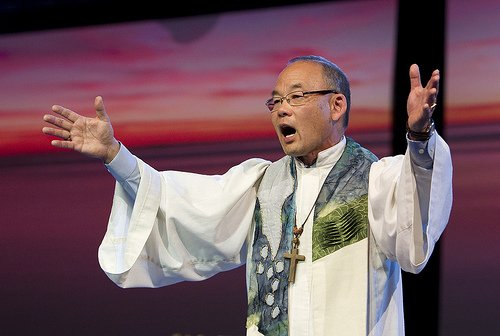 Bishop Robert T. Hoshibata preaches on the healing power of love at the April 26 evening service at the 2012 General Conference.