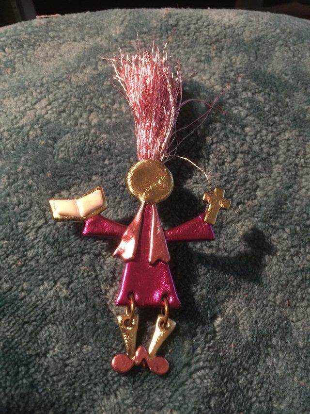 Pink Clergywoman
