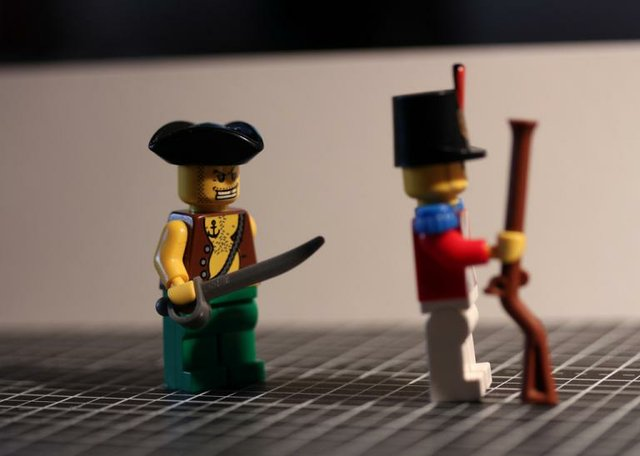 Lego Pirate Stabbing Soldier