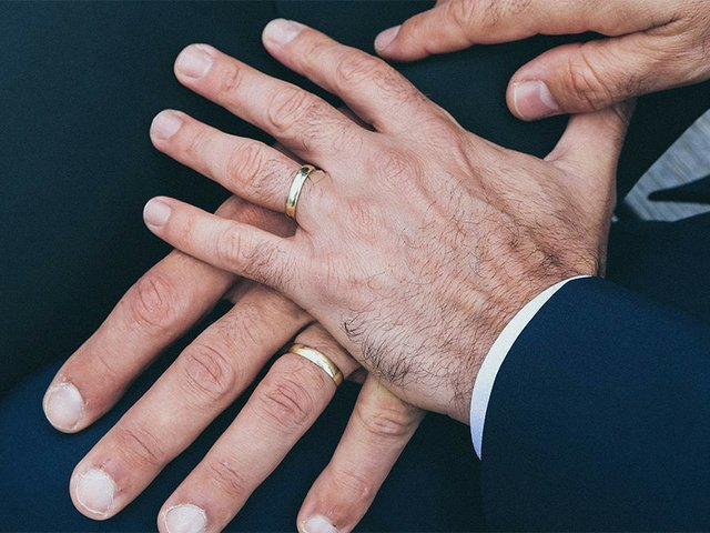 Same-sex couple hands