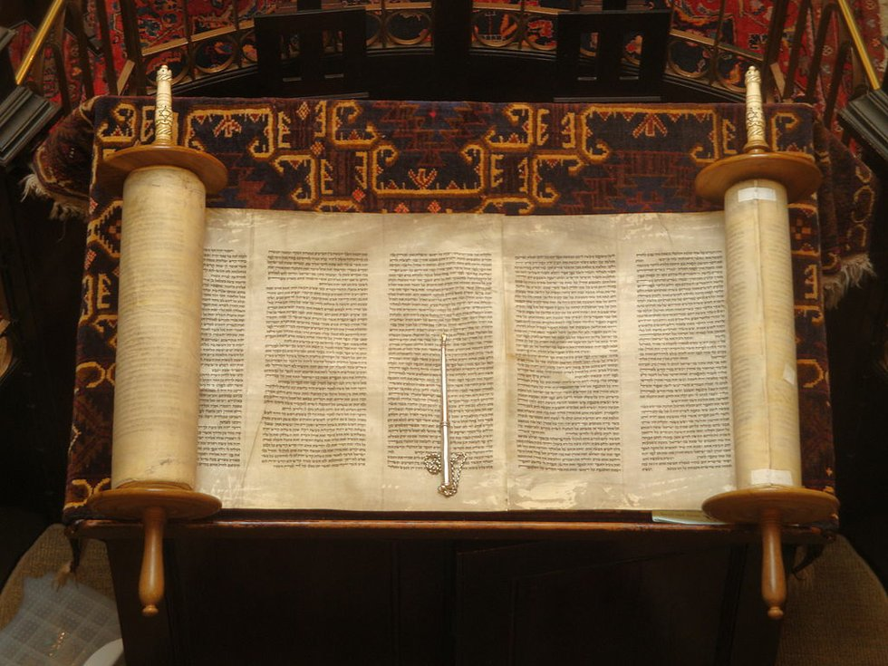 A Torah scroll and pointer used to read scripture.