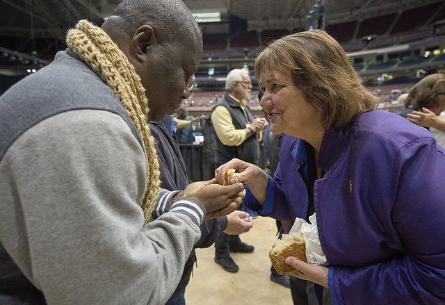 Bishop Oliveto Gives Bread