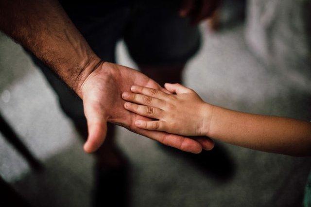 Adult child hands
