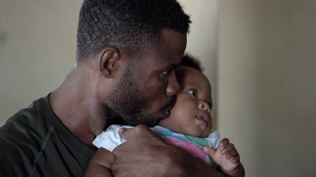 Black Father with baby