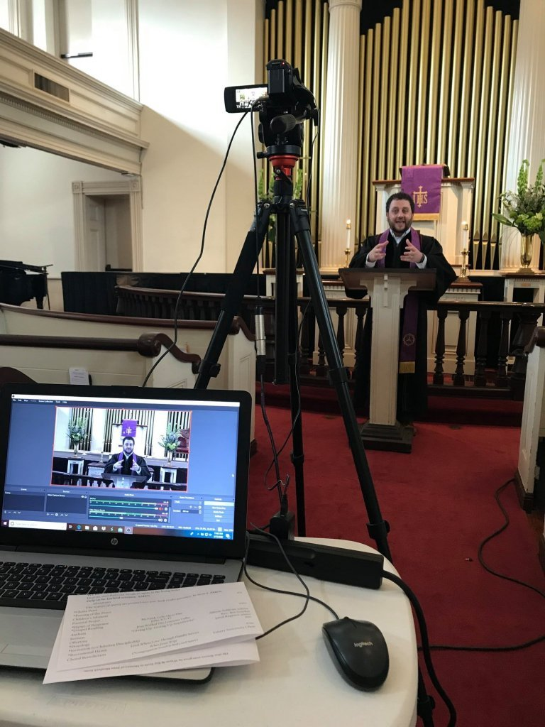 The Rev. Ben Gosden (in background) leads virtual worship using the equipment in the foreground. (Courtesy Photo).