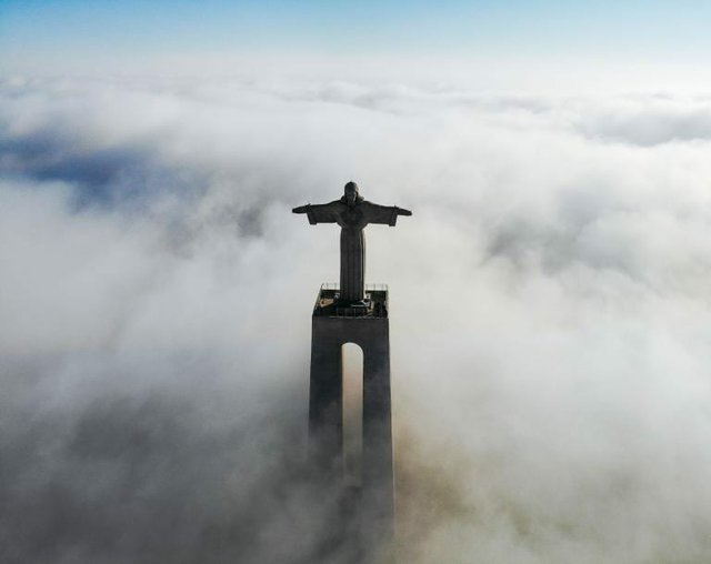 Christ above clouds