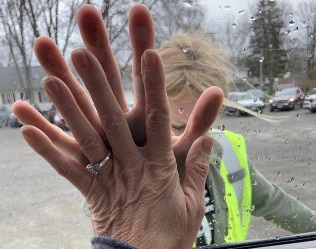 Hands at window