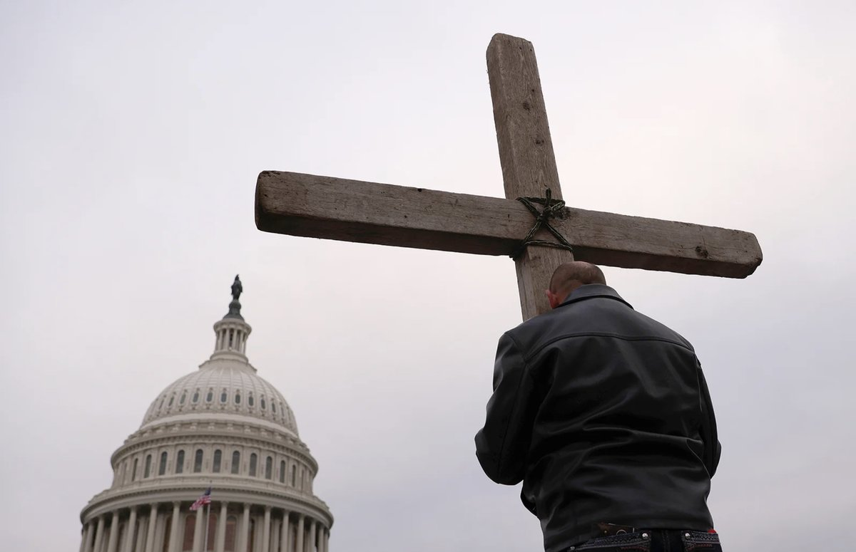 Supporters of President Donald Trump put up a cross outside the U.S. Capitol on Jan. 6, 2021. (Photo by Win McNamee/Getty Images via Religion News Service)
